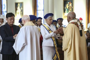 Passionist Father Jerome McKenna, second from left, and Archbishop Wilton D. Gregory, right, distribute holy Communion to the congregation during the Jan. 16 Martin Luther King Jr. Eucharistic Celebration at Atlanta's Shrine of the Immaculate Conception. Photo By Michael Alexander
